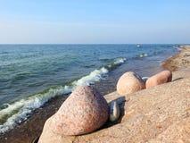 Different shape stones on Baltic sea coast, Lithuania stock image
