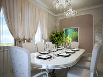 Beautiful dining with built-in wall aquarium Stock Photography