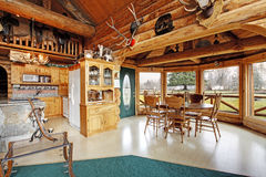 Beautiful dining room in log cabin house stock photos