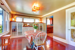 Beautiful dining room with shiny cherry hardwood. Royalty Free Stock Photos