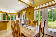 Beautiful dining table with chairs in farm house Royalty Free Stock Photos