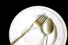Beautiful dinning plate and brass silver ware Royalty Free Stock Photos