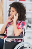 Beautiful disabled woman calling Royalty Free Stock Image