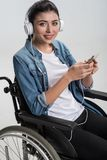 Beautiful disabled woman listening to music Stock Image