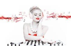 Beautiful disc jockey mixing music Stock Photos