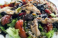 A beautiful dish. Vegetable salad with sesame seeds.  stock photo