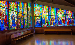 Colorful Stain Glass in a Church. Beautiful display of biblical traditions held by the Catholic Church Stock Photography
