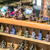 Beautiful display of bronze Buddha, Ganesh and Asian woman statues royalty free stock photo