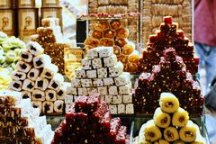 Beautiful display of Turkish delights at Egyptian Spice Bazaar. Istanbul, Turkey 10 August 2018. Colourful display of Turkish delights arranged in beautiful royalty free stock photo