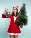 Beautiful displeased woman in new year costume with a new year b Royalty Free Stock Images