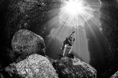 Beautiful diver underwater with sun rays Royalty Free Stock Photography