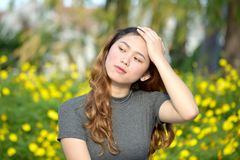 Beautiful Diverse Female Memory Problems. An attractive and asian person royalty free stock photos
