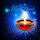 Beautiful  diwali diya in shiny glowing blue color backgro. Und with stylish text Royalty Free Stock Photography