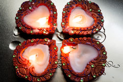 Beautiful diyas for diwali. Beautiful earthenware diyas decorated with paint and gemstones on a silver platter Royalty Free Stock Image
