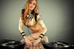 Beautiful DJ girl on decks Stock Photo