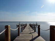 Beautiful dock on the ocean. Very beautiful picture of a dock out on the very blue ocean Royalty Free Stock Photography
