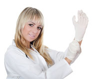 The beautiful doctor dresses gloves Stock Photos