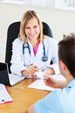 Beautiful doctor giving a prescription Stock Images
