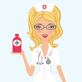 Beautiful doctor holding medicine Stock Images