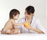 Beautiful doctor with little girl Royalty Free Stock Photo