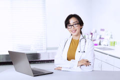 Beautiful doctor looks confident in clinic Royalty Free Stock Images