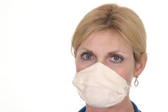Beautiful Doctor or Nurse in Surgical Mask 13. Headshot photo of beautiful nurse or doctor with stethoscope and surgical mask Royalty Free Stock Image