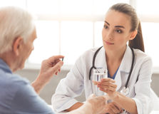 Beautiful doctor and patient Stock Photography