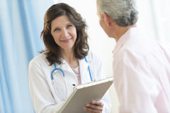 Beautiful Doctor Standing With Patient In Clinic Stock Photos