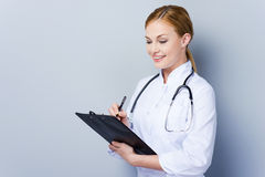 Beautiful doctor at work. Stock Images