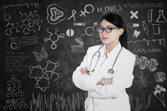 Beautiful doctor with written formula Stock Images