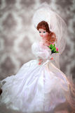 Beautiful doll bride in a wedding dress Royalty Free Stock Photo