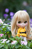 Beautiful doll in the garden Stock Photos