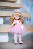 The beautiful doll. In a pink dress Royalty Free Stock Photography