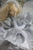 Beautiful doll in silver dress Stock Image