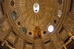 Beautiful dome in the Cathedral interior in Seville Stock Images