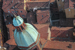 Beautiful dome of an old church on a background of red roofs in Bologna, Italy.  stock photography
