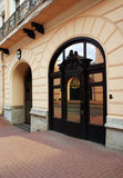 Beautiful  door. Beautifula entrance to the building. Arched mirror door with decor Stock Images