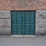 Small green door in Åmål royalty free stock photo