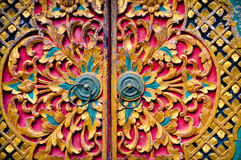 Beautiful door. Colorful door with wood carvings Royalty Free Stock Photos
