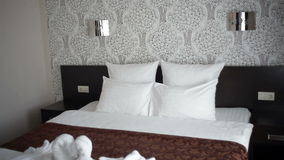 Beautiful double bed in the hotel stock video