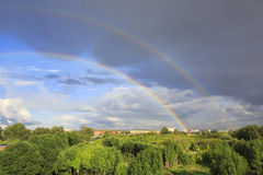 Beautiful double rainbow over the city. Royalty Free Stock Images