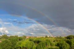 Beautiful double rainbow over summer city. Beautiful double rainbow over the summer city Stock Photography