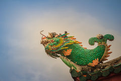 Beautiful dragon fish statue on the roof of Chinese temple. In the Thailand royalty free stock images