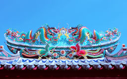 Beautiful dragon statue decorated on chinese temple roof against Royalty Free Stock Photo