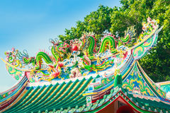 Beautiful Dragons Sculpture on the Chinese Pavilion Roof in the Royalty Free Stock Images