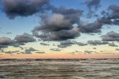 Beautiful dramatic cloudscape over the sea at sunset Stock Photo