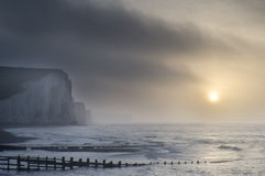 Beautiful dramatic foggy Winter sunrise Seven Sisters cliffs lan Royalty Free Stock Photography