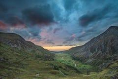 Beautiful dramatic landscape image of Nant Francon valley in Sno. Beautiful moody landscape image of Nant Francon valley in Snowdonia during sunset in Autumn stock image