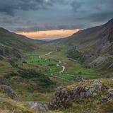 Beautiful dramatic landscape image of Nant Francon valley in Sno. Beautiful moody landscape image of Nant Francon valley in Snowdonia during sunset in Autumn stock photo