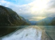 Beautiful and dramatic Norway landscape with mountains and sea in fjord Royalty Free Stock Photo